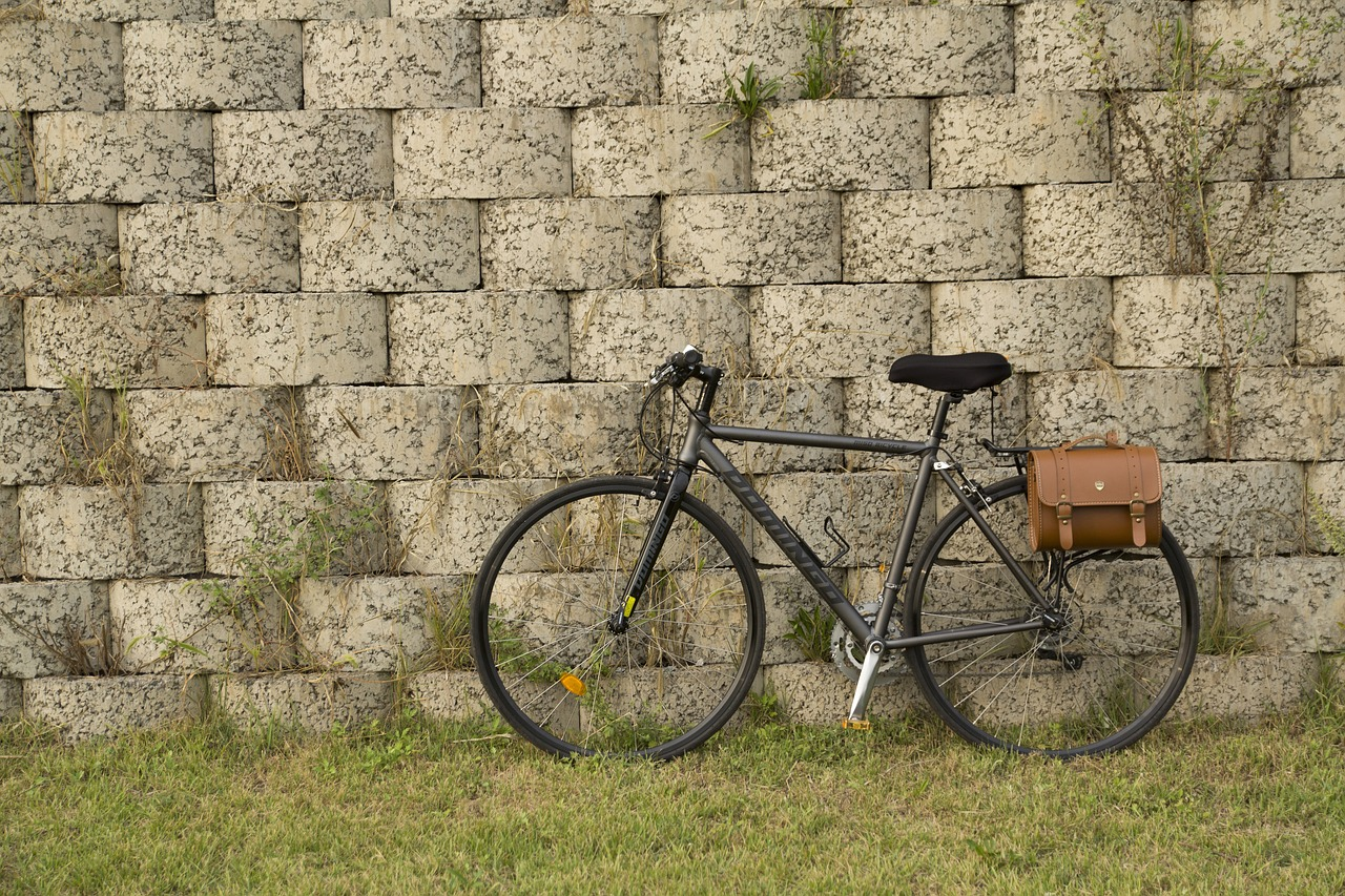 a lovely hybrid bike with a leather pannier bag