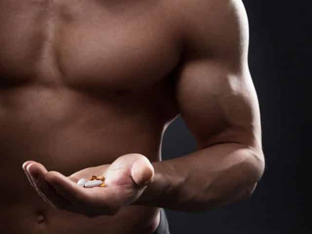 Men with testosterone booster pills